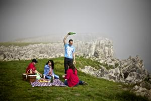Group of people picnicking with cider