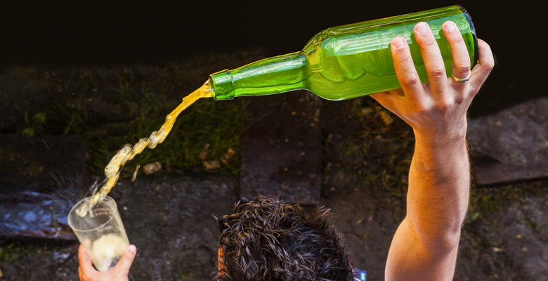 Pouring natural (still) cider from a height