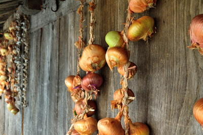 Onions hanging outside a raised granary